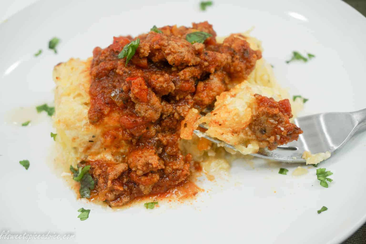 Baked Spaghetti Squash Spasagna -- Creamy four cheese Bechamel sauce and crispy bacon are tossed with spaghetti squash and baked to crusty perfection then topped with spaghetti sauce. -- lilsweetspiceadvice.com