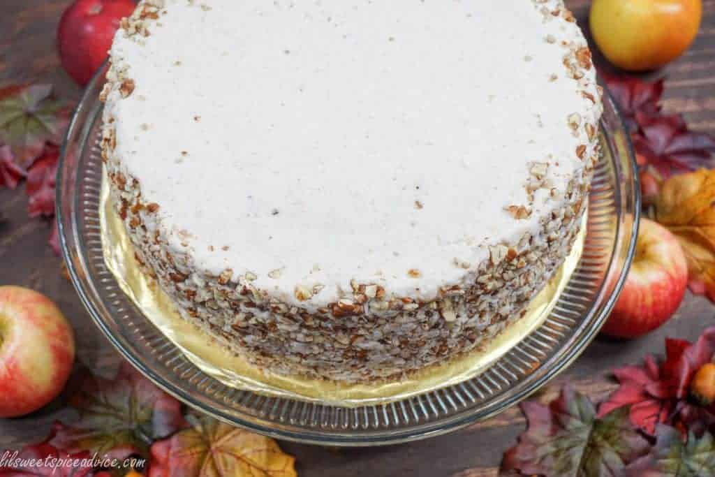 Crown Royal Apple Pecan Cake is the new Carrot Cake! Grated Honeycrisp apples, Crown Royal Apple, and chopped pecans are melded into a spiced cake batter and then frosted with chai spiced buttercream.