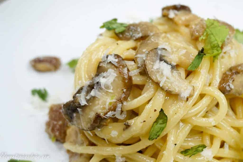 Roasted Garlic Mushroom Spaghetti Carbonara -- This is my twist on the classic spaghetti carbonara! Diced pork belly, sweet roasted garlic, sauteed mushrooms, and serrano pepper give this spaghetti carbonara an incredible punch of flavor. -- lilsweetspiceadvice.com