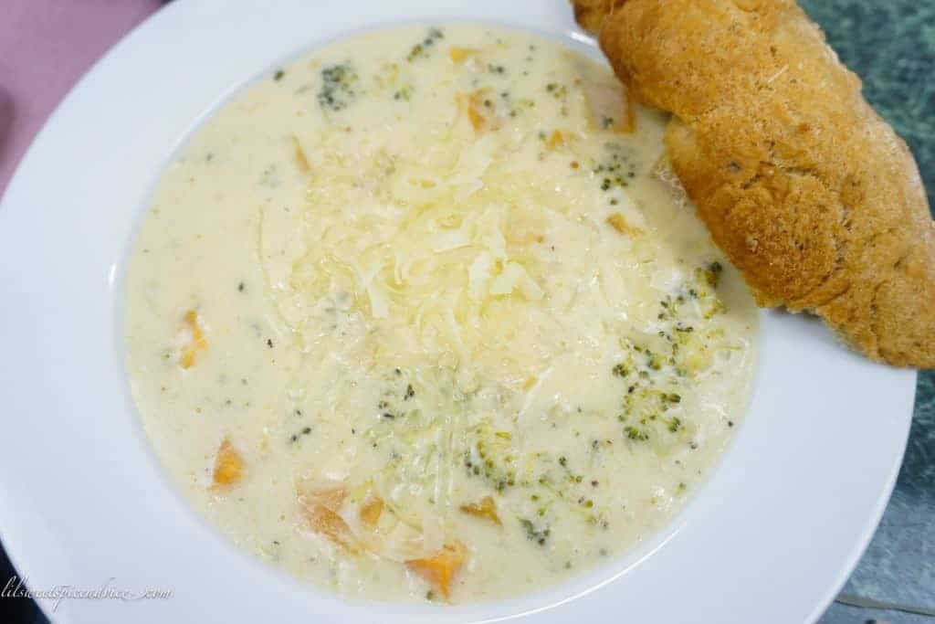 Broccoli White Cheddar Soup with Butternut Squash-- This easy, oh-so-comforting broccoli cheddar soup gets elevated by warming spices such as ginger, cumin, etc. and roasted butternut squash adds the perfect textural component to make this soup a winner! -- lilsweetspiceadvice.com #broccolicheddarsoup #butternutsquashsoup #comfortingsoup