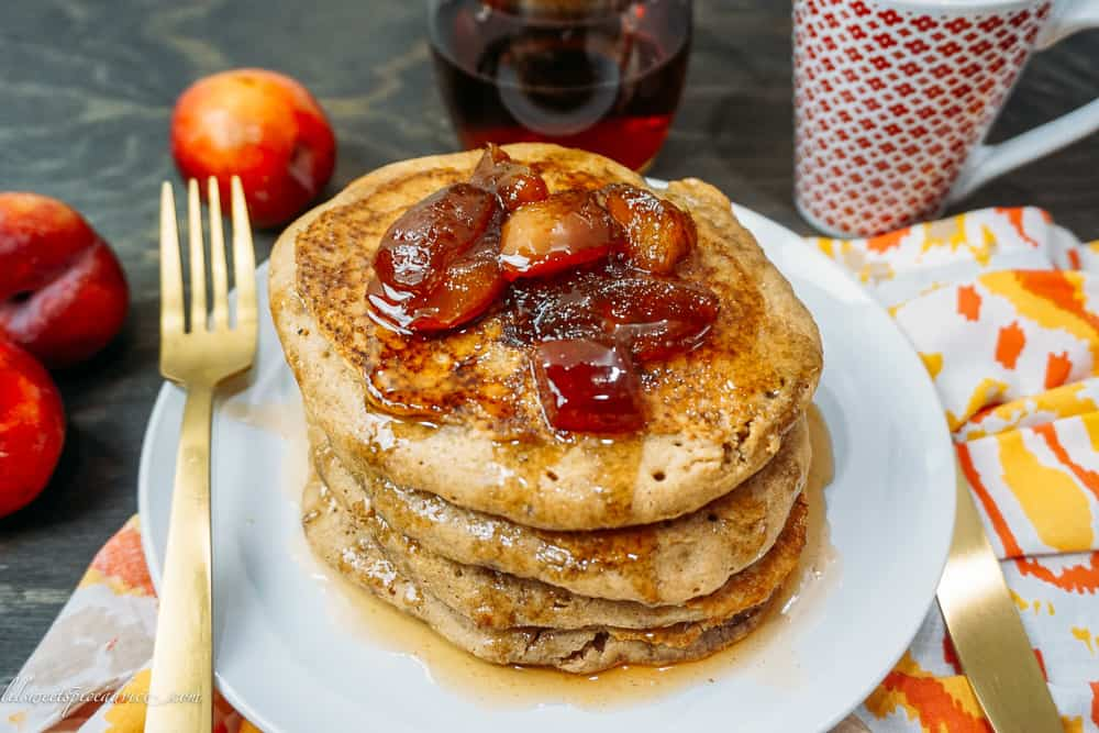 Cinnamon Vanilla Whole Wheat Pancakes with Homemade Plum Syrup -- The perfect fluffy and crispy whole wheat pancakes to satisfy all of your guests. Top the pancakes with the homemade plum syrup and you'll think you've transported to heaven! -- lilsweetspiceadvice.com #wholewheatpancakes #crispypancakes #homemadesyrup #cinnamonpancakes