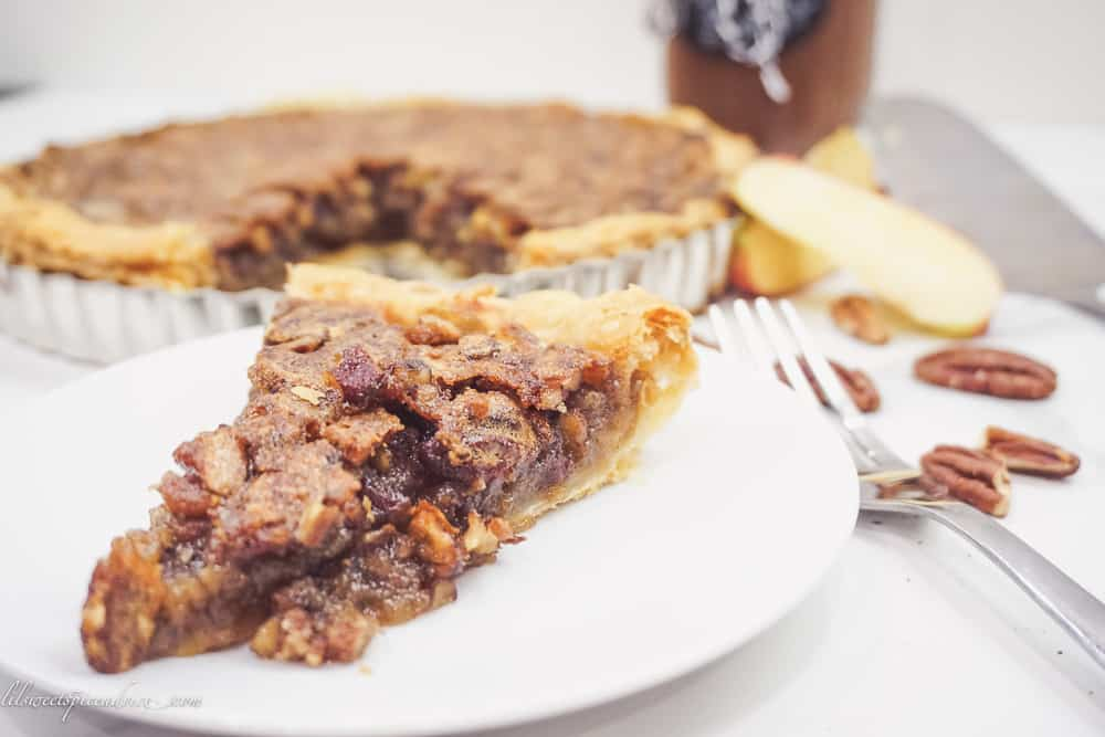 Apple Butter Pecan Pie with Puff Pastry Crust -- This pecan pie made without corn syrup gets a nice spiced addition from apple butter to make the greatest pecan pie ever! -- lilsweetspiceadvice.com #applebutterpecanpie #nocornsyruppecanpie #organicpecanpie #healthypecanpie #puffpastrypecanpie