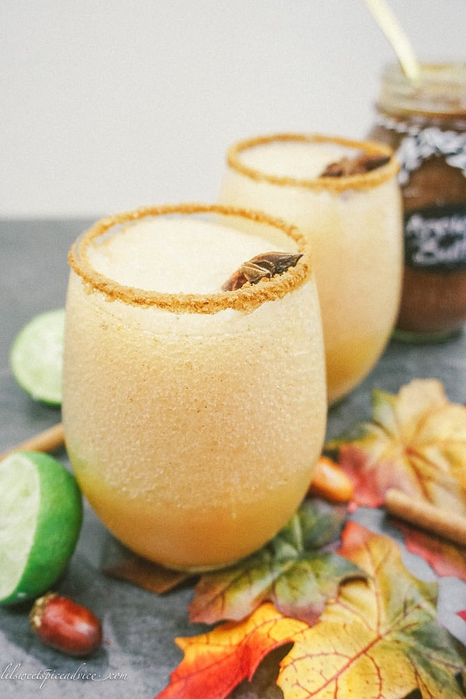 Frozen Apple Butter Margaritas -- Apple butter and apple cider get blended together in this festive and tasty Frozen Apple Butter Margarita! -- lilsweetspiceadvice.com #frozenapplebuttermargaritas #frozenapplemargaritas #applemargaritas #applebuttercocktails