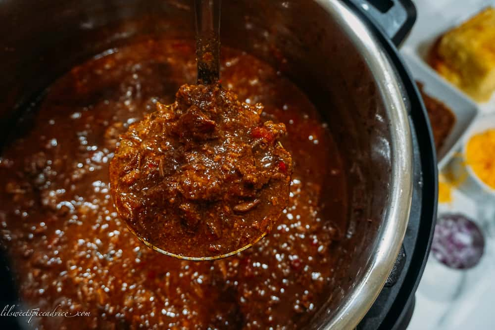 Instant Pot Texas Chili -- This bold and spicy Instant Pot Texas Chili is full of chunky cuts and ground chuck roast, spiced with a homemade chili paste, and is on your table in under two hours and tastes like it's cooked for hours! -- lilsweetspiceadvice.com #InstantPotTexasChili #TexasChili #chilinobeans #lilsweetspiceadvice
